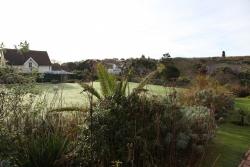 Rottingdean Kiplingův dům - v zahradách je místo i na kroketové hřiště